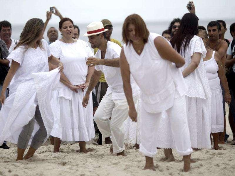 Worshippers of Afro-Brazilian religion Umbanda attend a ceremony in tribute to Iemanja, the goddess of the sea, in Copacabana Beach in Rio de Janeiro.