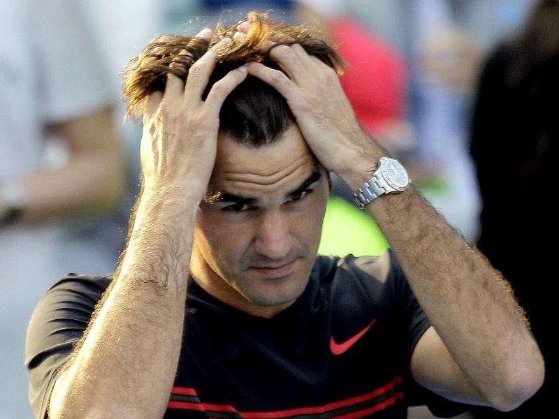 Roger Federer from Switzerland reacts after he lost the match to Serbia's Novak Djokovic during the second day of Abu Dhabi Mubadala Tennis Championship, United Arab Emirates. (AP Photo/Kamran Jebreili)
