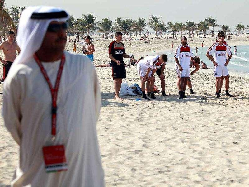 AC Milan players attend a training session at Al-Mamzar Beach in the Gulf emirate of Dubai on December. The Italian champions will face Qatar-backed French club Paris Saint-Germain in the Challenge Cup on January 4, 2012. AFP PHOTO