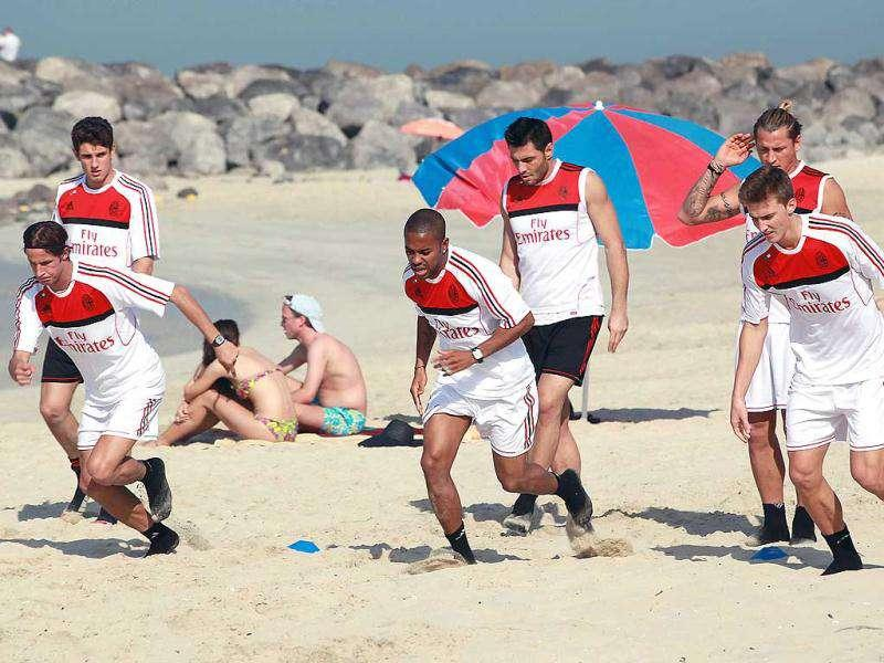 AC Milan players take part in a training session at Al-Mamzar Beach in the Gulf emirate of Dubai. The Italian champions will face Qatar-backed French club Paris Saint-Germain in the Challenge Cup on January 4, 2012. AFP PHOTO