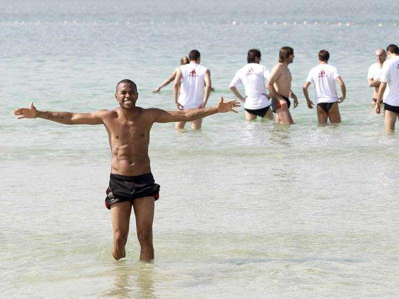AC Milan's Robinho (L) gestures during a training session at Mamzar Beach in Dubai. The team arrived in Dubai for their winter training camp, and will play a match against Paris Saint Germain during the Dubai Football Challenge on January 4, 2012. REUTERS PHOTO