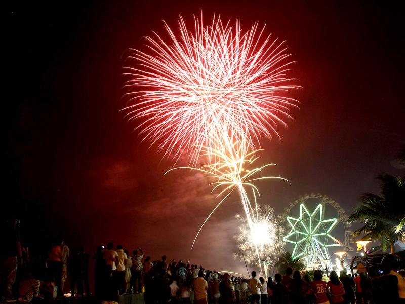 Thousands of revellers watch as fireworks light up the sky to welcome the New Year in Manila, Philippines. AP Photo