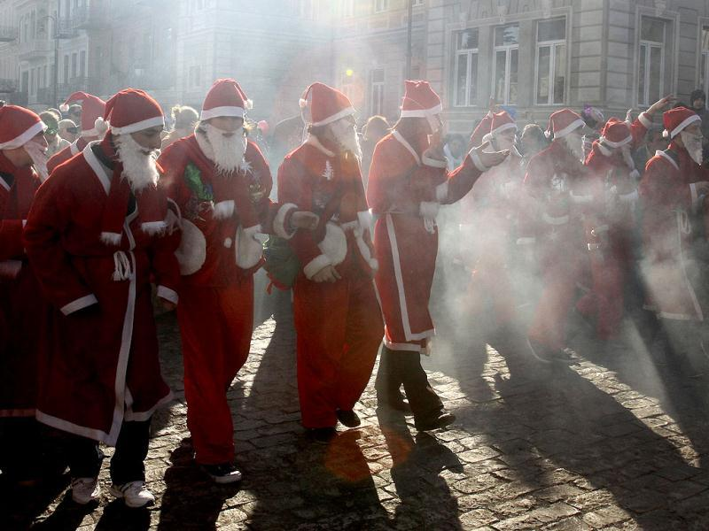 People dressed as Santa Clause parade in downtown Tbilisi, Georgia. AP Photo