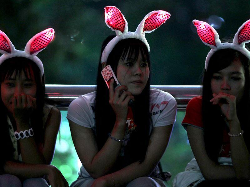 Visitors wearing illuminated bunny ears gather during the new year's 2012 celebrations in Kuala Lumpur. AFP Photo