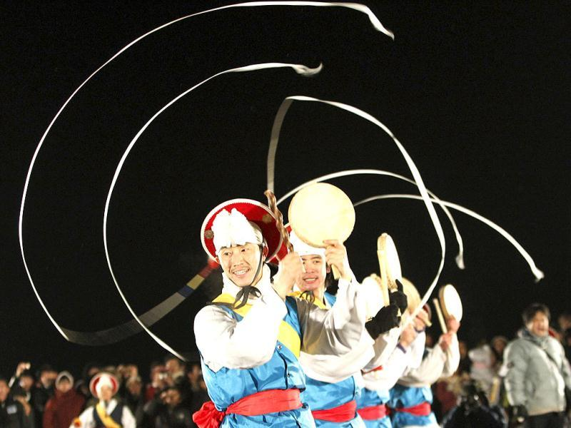 South Koreans in traditional costumes perform to celebrate the New Year near the border village of Panmunjom that separates the two Koreas, at Imjingak Pavilion in Paju, South Korea. AP Photo