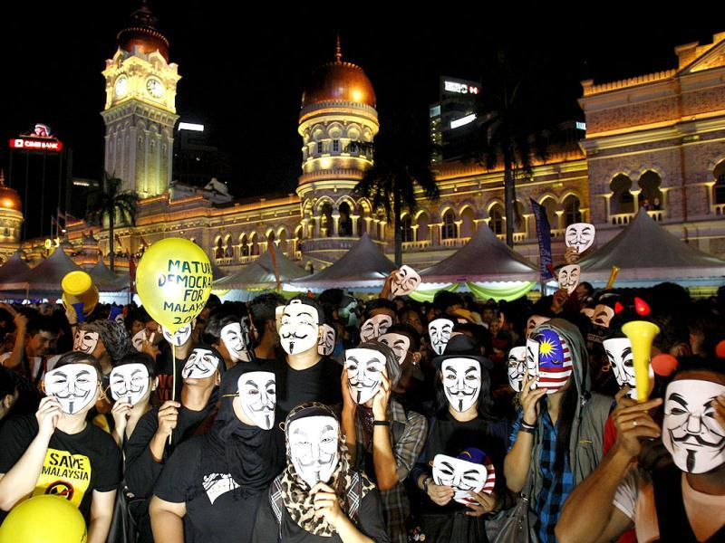 Activists wear Guy Fawkes masks during New Year's Eve celebrations at Independence Square in Kuala Lumpur, Malaysia. AP Photo