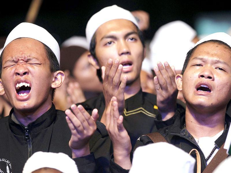 Indonesian Muslims pray during a mass prayer event for the Nation on New Year's Eve in the area of the National Monument (Monas) in Jakarta. Reuters Photo
