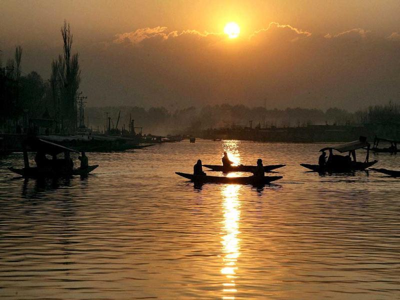 Boats and shikaras at Dal Lake during the last sunset of 2011, in Srinagar. PTI