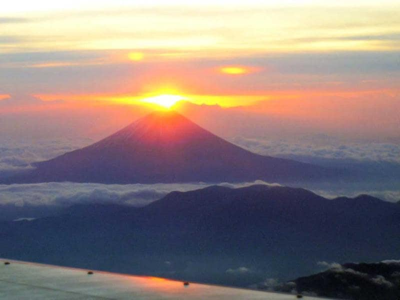 This aerial shot shows the rising sun on new year's behind from Mt Fuji, observed at Yamanashi prefecture. All Nippon Airways (ANA) organised a rising sun obsercvation flight with 137 passengers on New Year's day. AFP