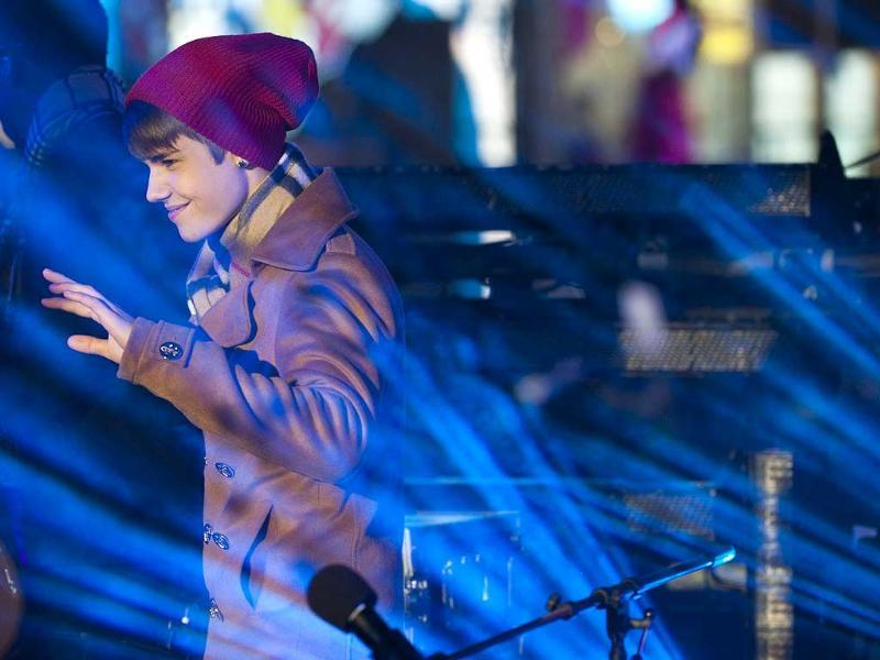 Justin Bieber performs in Times Square during New Year's Eve celebrations in New York. (AP Photo/Charles Sykes)