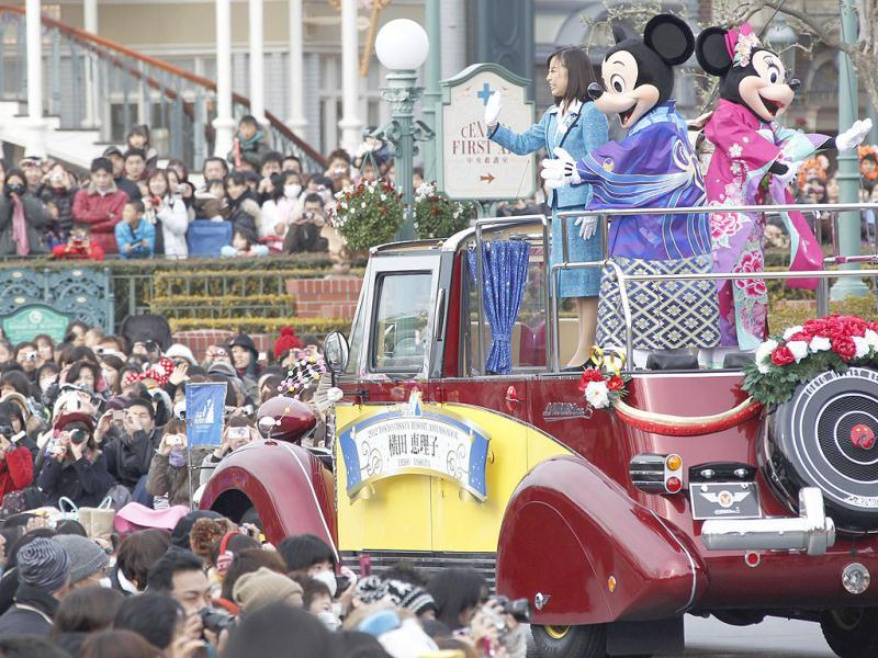 Japanese kimono-clad Mickey Mouse and Minnie Mouse wave to visitors and guests during the annual new year's Disney characters' parade at Tokyo Disneyland in Urayasu, near Tokyo, Japan. Accompanied by the characters at left is Eriko Yokota, the ambassador of Tokyo Disney Resort. AP Photo/Koji Sasahara