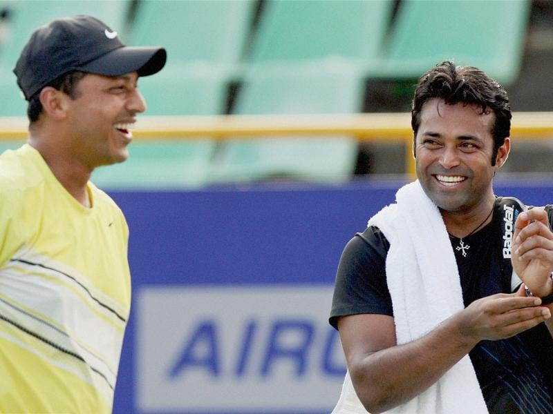 Leander Paes shares a light moment with Mahesh Bhupathi during a practice session for ATP Chennai Open 2012 in Chennai. PTI Photo