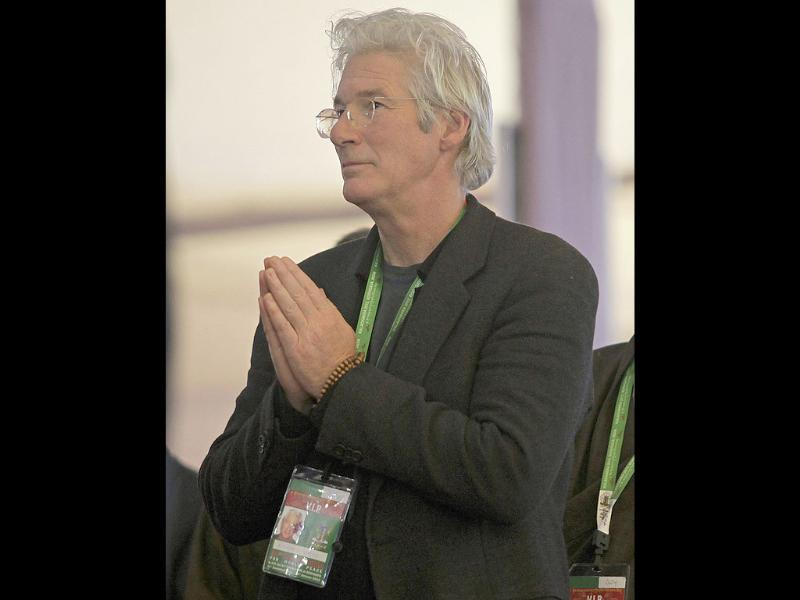 Hollywood actor Richard Gere listens to the Dalai Lama on the first day of Buddhist festival Kalachakra, in the town of Bodh Gaya in Bihar, believed to be the place where Buddha attained enlightenment. AP Photo