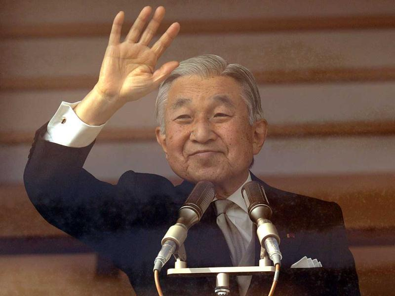 Japanese Emperor Akihito waves to well-wishers from the balcony of the Imperial Palace in Tokyo. Emperor Akihito and his family greeted well-wishers in customary New Year public apperances.