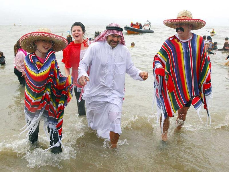 Swimmers are dressed for more exotic climes, in fancy dress for the Gosport and Fareham Inshore Rescue Service's New Year's Day Charity Swim in the chilly waters of The Solent, in Gosport, England.