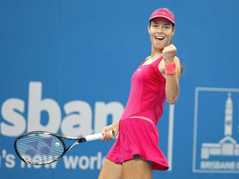 Ana Ivanovic of Serbia celebrates after winning a point against Tamira Paszek of Austria during their match at the Brisbane International tennis tournament.