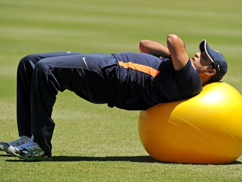 VVS Laxman stretches during a practice session at the Sydney Cricket Ground (SCG) in Sydney. AFP Photo/Greg Wood