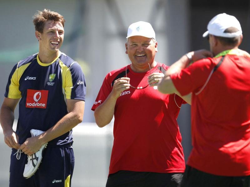 Australia's James Pattinson (L) shares a joke with umpire Marais Erasmus (C) of South Africa in the nets during a practice session at the Sydney Cricket Ground. Reuters/Tim Wimborne