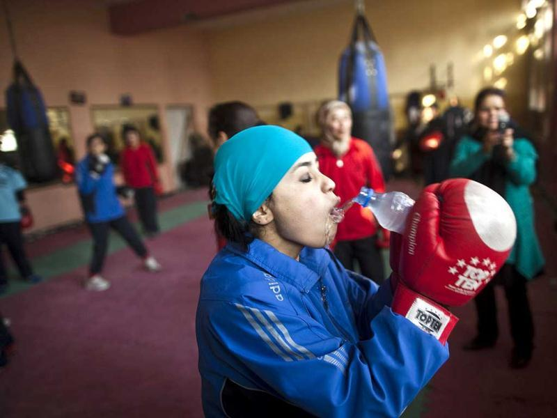 An Afghan woman drinks water during a practice session inside a boxing club in Kabul. Female boxing is still relatively unusual in most countries, but especially in Afghanistan, where many girls and women still face a struggle to secure an education or work, and activists say violence and abuse at home is common. REUTERS