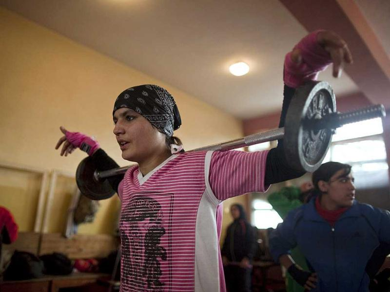 Sadaf Rahimi lifts weights during a practice session in a boxing club in Kabul. Female boxing is still relatively unusual in most countries, but especially in Afghanistan, where many girls and women still face a struggle to secure an education or work, and activists say violence and abuse at home is common. REUTERS