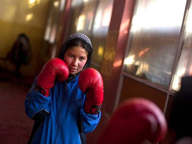 An Afghan woman practises inside a boxing club in Kabul. Female boxing is still relatively unusual in most countries, but especially in Afghanistan, where many girls and women still face a struggle to secure an education or work, and activists say violence and abuse at home is common.REUTERS