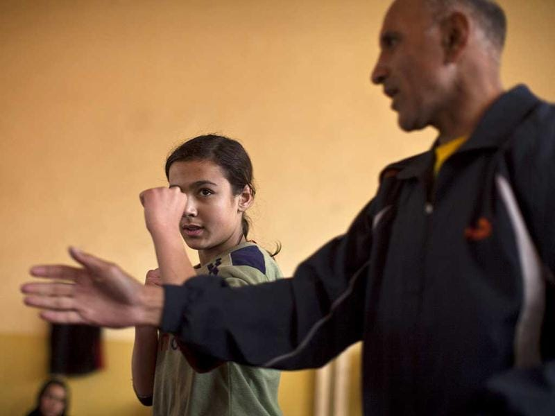 An Afghan woman receives training from a coach during a practice session inside a boxing club in Kabul. Female boxing is still relatively unusual in most countries, but especially in Afghanistan, where many girls and women still face a struggle to secure an education or work, and activists say violence and abuse at home is common. REUTERS