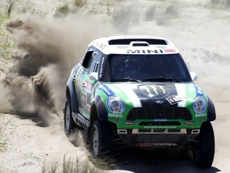 France's Stephane Peterhansel and co-pilot Jean-Paul Cottret drive their Mini Monsterduring the first stage of the fourth South American edition of the Dakar Rally from Mar Del Plata to Santa Rosa de la Pampa.