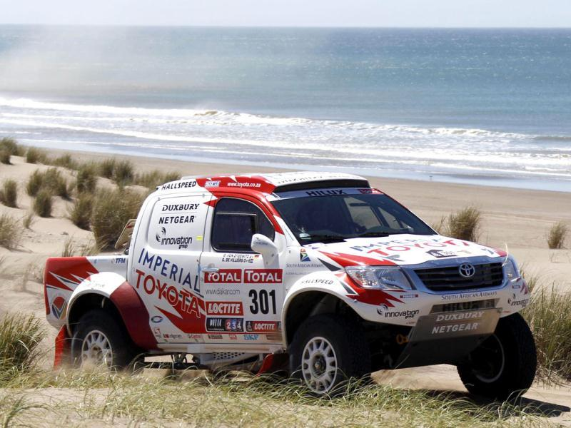 South Africa's Giniel De Villiers an co-pilot Germany's Dirk Zitzewitz drive their Toyota during the first stage of the fourth South American edition of the Dakar Rally from Mar Del Plata to Santa Rosa de la Pampa.