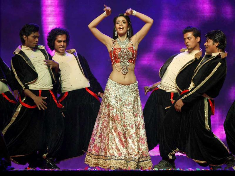 Mallika looks cheerful as she performs. (PTI)
