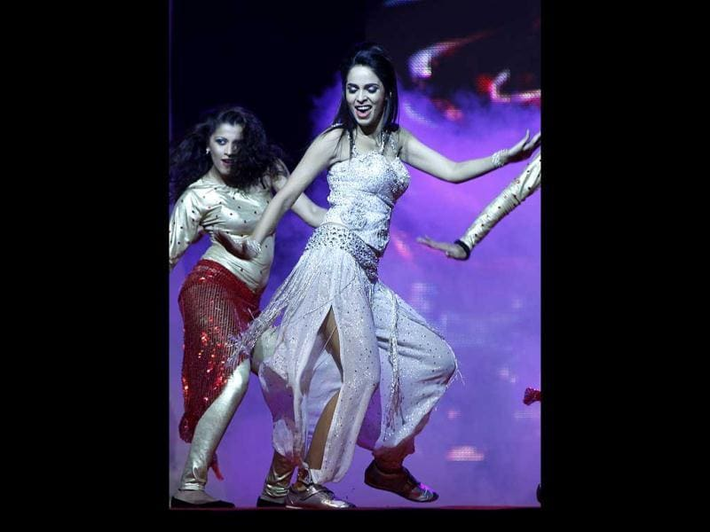 Mallika Sherawat performs on stage.