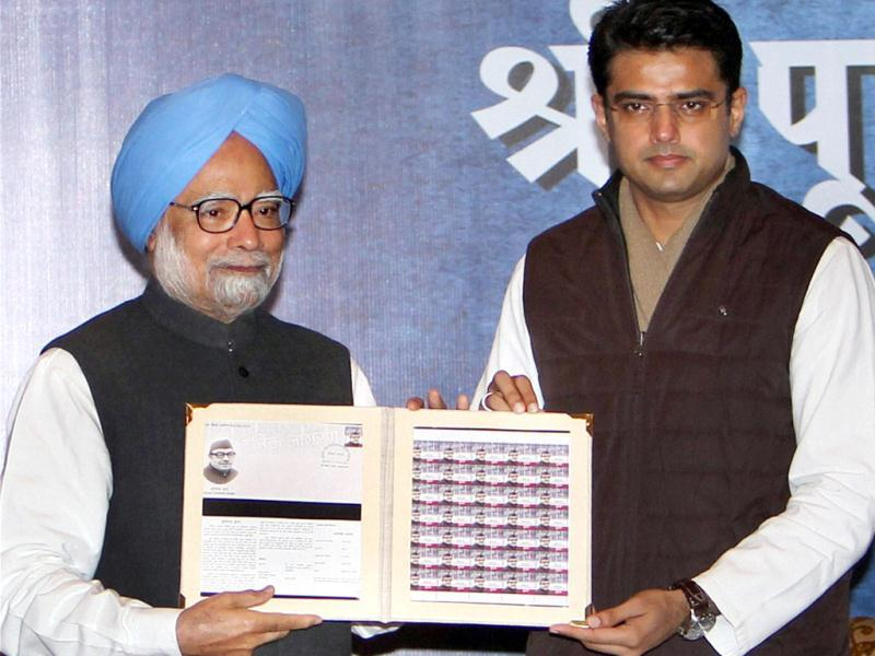 Prime Minister Manmohan Singh and minister of state for communication and IT Sachin Pilot release postage stamp in memory of Dainik Jagran founder late Puran Chandra Gupta in New Delhi. PTI/Atul Yadav