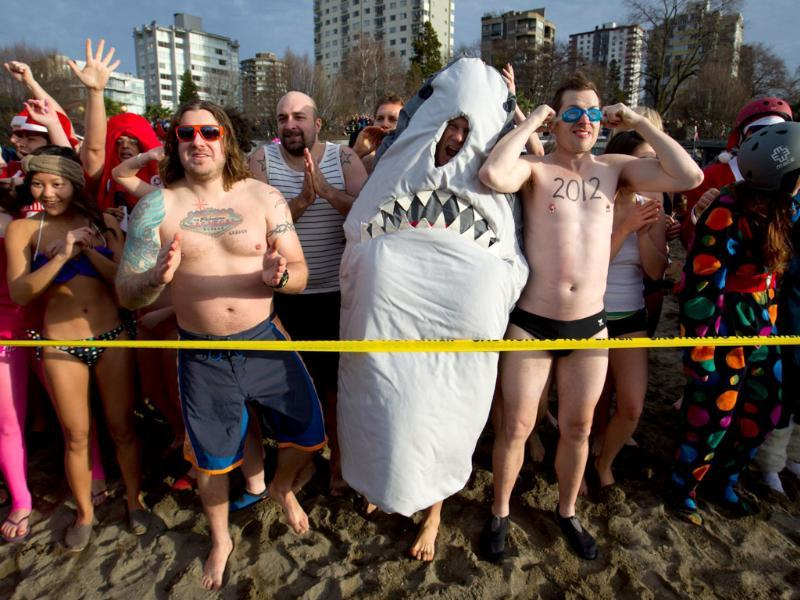 Participants prepare to enter the frigid waters of English Bay during the 92nd annual Polar Bear Swim in Vancouver, B.C. (AP Photo/The Canadian Press, Darryl Dyck)