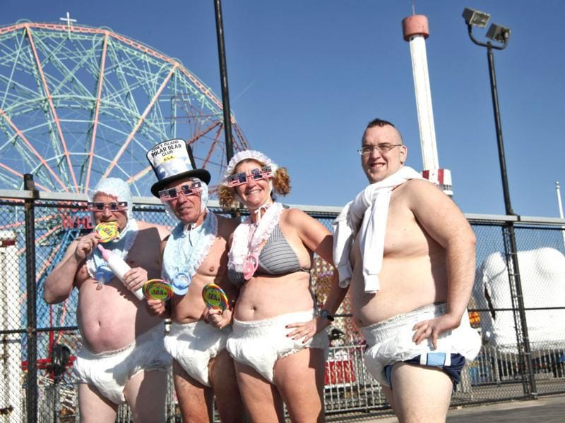 Revelers take part in the Coney Island Polar Bear Club's annual New Year's Day Polar Bear Swim in New York's Coney Island. (Reuters/Kena Betancur)