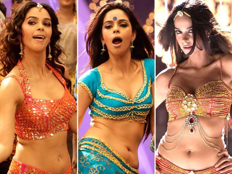 Mallika Sherawat turned the screen red hot as she shook not only her leg but entire body on the tunes of Tamil version of Munni Badnaam Hui. Scoot to get a peek!