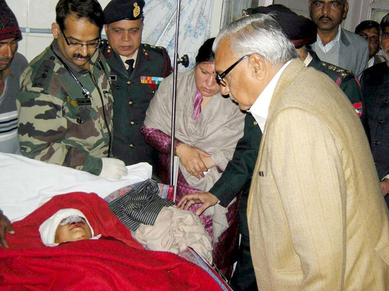 Haryana chief minister Bhupinder Singh Hooda visits students injured in an accident in which 11 children and the driver of a school van were killed, at the Army Hospital in Ambala Cantonment.