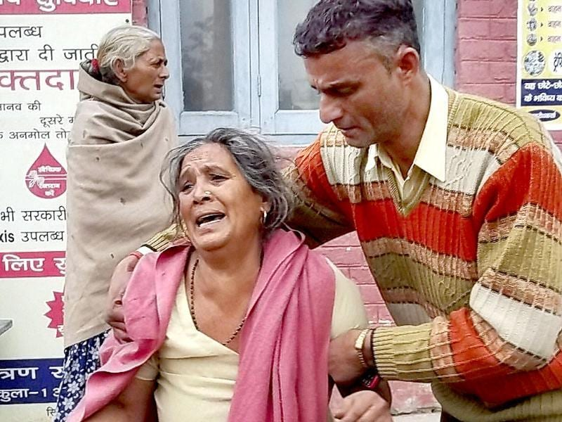 A woman cries after the death of her child at a hospital following an accident in Ambala. PTI Photo