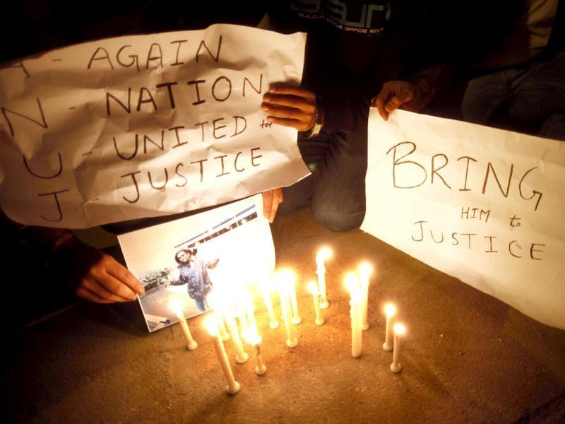 Friends of Anuj Bidve who was gunned down on Dec 26 in Salford, hold candles during a peace march near the British embassy in New Delhi. Bidve was on a holiday break with a group of nine friends when he was shot in UK. AP/Saurabh Das