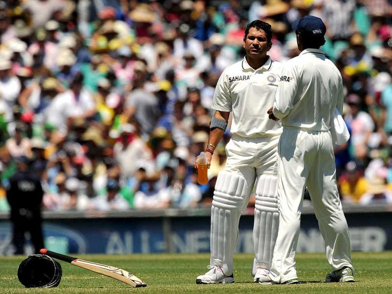 Sachin Tendulkar waits for new partner VVS Laxman to come out onto the ground on day one of the second cricket Test against Australia at the Sydney Cricket Ground. AFP