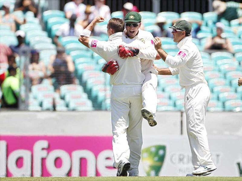 Ricky Ponting moves in as Peter Siddle celebrates with wicket keeper Brad Haddin after they combined to dismiss Virat Kohli during the second cricket Test at the Sydney Cricket Ground. Reuters