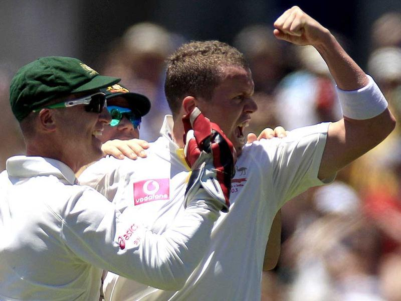 Peter Siddle celebrates taking the wicket of Virat Kohli for 23 runs in their cricket test match at the Sydney Cricket Ground in Sydney. AP Photo