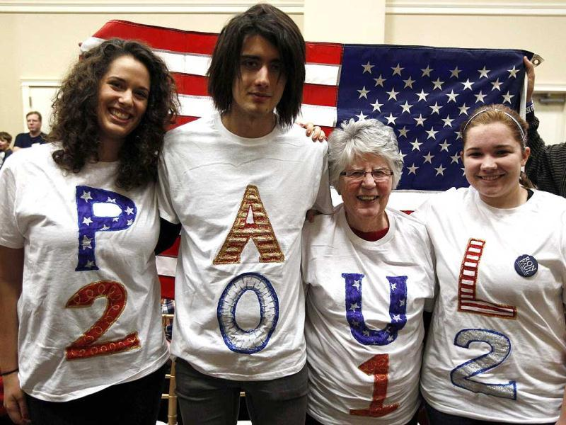 Supporters of US Republican presidential candidate and Congressman Ron Paul (R-TX) attend a campaign stop in Cedar Falls, Iowa, January 2, 2012. The Iowa Caucus will be held on January 3. Reuters