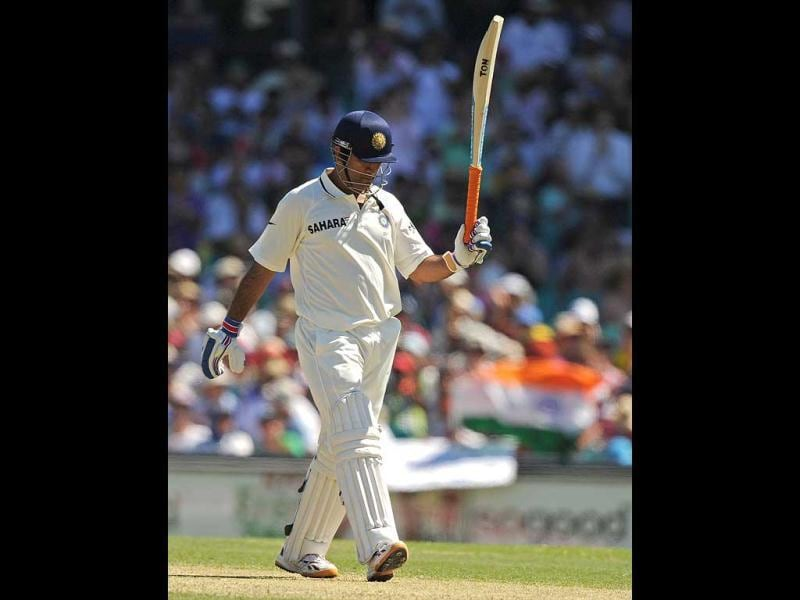 Mahendra Dhoni raises his bat after reaching his 50 on day one of the second cricket Test against Australia at the Sydney Cricket Ground. AFP