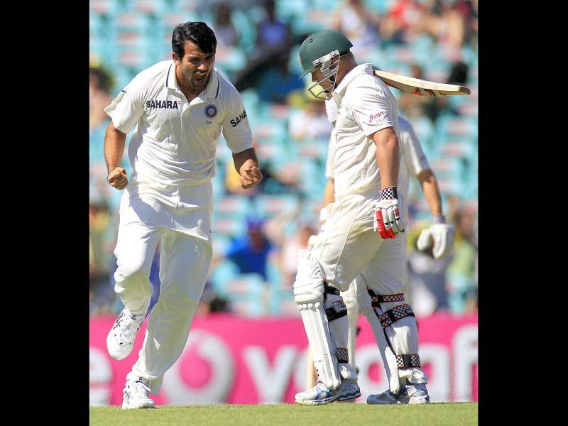 Zaheer Khan celebrates taking the wicket of Australia's David Warner for 8 runs in their cricket test match at the Sydney Cricket Ground in Sydney. AP