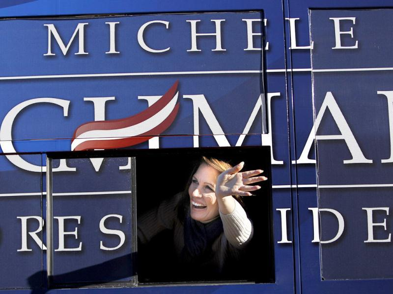 Republican presidential candidate Rep. Michele Bachmann, R-Minn, waves from her bus following a campaign stop in West Des Moines, Iowa. AP Photo/Eric Gay
