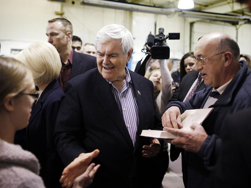 Republican presidential candidate former Speaker Newt Gingrich, stops by his campaign headquarters in Davenport, Iowa. AP Photo/Charles Dharapak