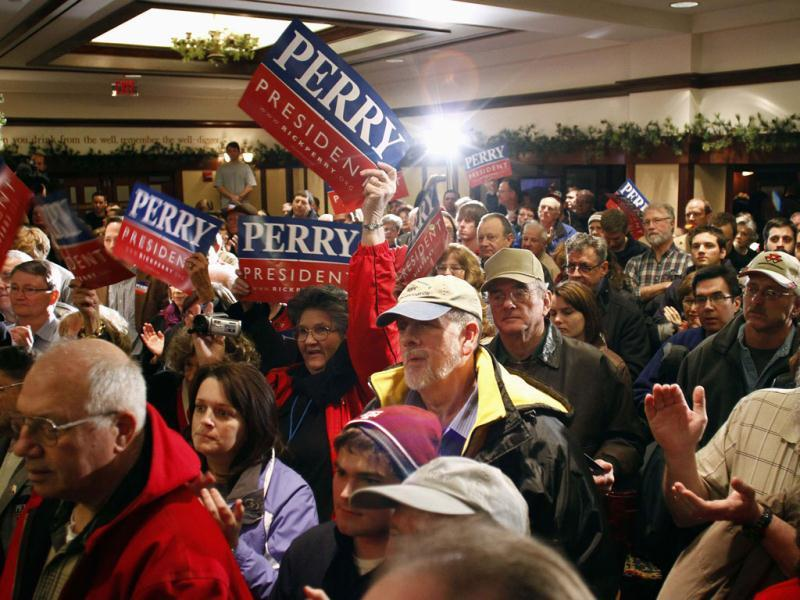 Supporters listen as US Republican presidential candidate and Texas Governor Rick Perry speaks during a campaign stop in Perry, Iowa. REUTERS/Joshua Lott