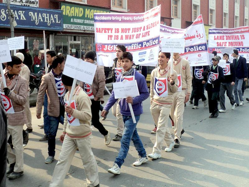 Students participate in an awareness rally during the 23rd Road Safety Week in Srinagar.