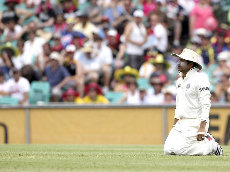 Sachin Tendulkar kneels on the ground after he caught out Australia's Ricky Ponting on day 2 of the second test match at the SCG in Sydney, Australia.(AP Photo/Rob Griffith)