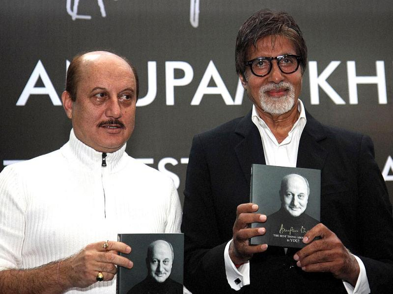 Amitabh Bachchan and Anupam Kher pose with the book.