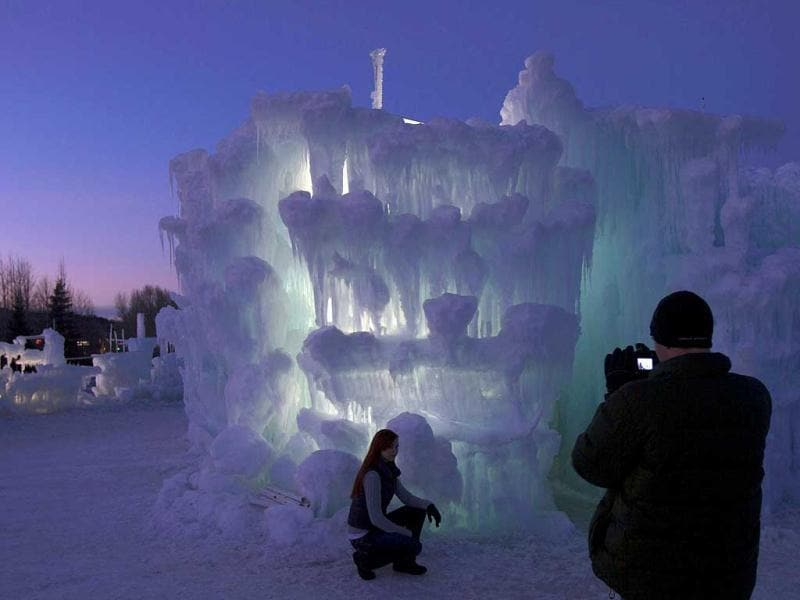 A tourist poses with ice formations at the ice castles in Silverthorne, Colorado. The ice castles consist of man-made walkways, tunnels, and arches of ice with no supporting structures, some reaching up to a height of 30 to 40 feet. Reuters/Nathan W Armes